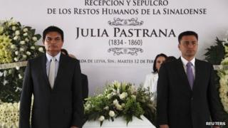 Mourners stand by the coffin of Julia Pastrana in Sinaloa de Leyva