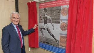 Peter Radford with the mural