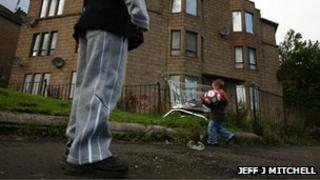 Children playing in run-down street