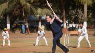 David Cameron playing cricket during his trip to India