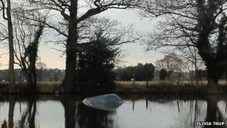 Car in fishing lake in Barking