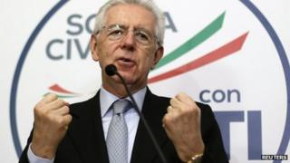 Italian Prime Minister Mario Monti gestures during a news conference in Rome February 25, 2013.