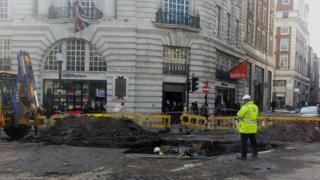 Repairmen in Regent Street on Monday