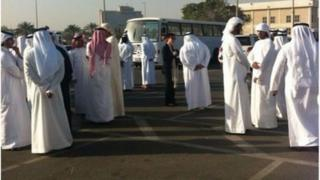 Families of detainees outside court building - picture from #uaedetainees (04/03/13)