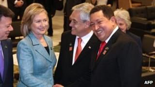 Hillary Clinton shakes hands with Hugo Chavez