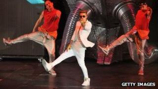 Justin Bieber with two backing dancers at Monday's concert