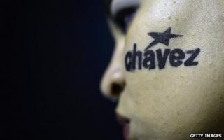 Mourner with Chavez written on her cheek