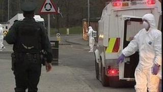 A policeman and forensics in Londonderry where four mortar bombs were discovered