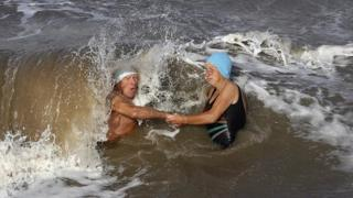 Richard and Dee Hamilton-Jones are caught in a huge wave.