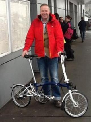 Mark Antwis with fold-up bike
