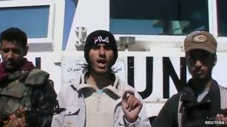 Frame from video showing rebels with captured peacekeepers' UN vehicle