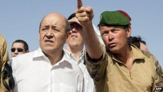 French defence minister Jean-Yves Le Drian with a French military commander in Ifoghas mountains, Mali, on 7/3/13