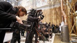 Media films the stove at the Sistine Chapel in the Vatican March 9