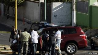 Investigators at the scene of the killing of Jalisco state's tourism minister