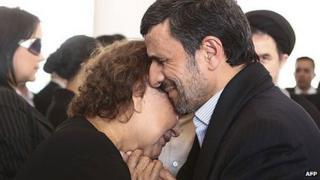 Mahmoud Ahmadinejad consoling Elena Frias de Chavez