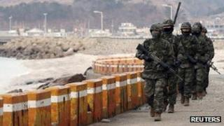 South Korean marines patrol on Yeonpyeong Island near the western maritime border between the two Koreas, 12 March 2013