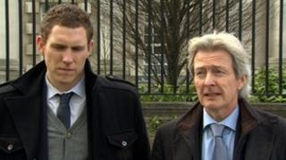 John McAreavey with his lawyer Paul Tweed outside Belfast High Court