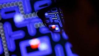 man playing Pacman