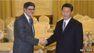 U.S. Treasury Secretary Jack Lew (L) shakes hands with China's President Xi Jinping as he arrives for their meeting at the Great Hall of the People in Beijing March 19, 2013.