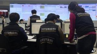 Employees of Korea Internet Security Center work after computer networks at two major South Korean banks and three top TV broadcasters went into shutdown mode en masse, at a monitoring room in Seoul, South Korea, Wednesday, March 20, 2013.