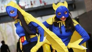 Two girls in superhero outfits