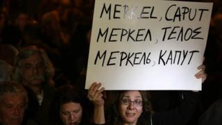 Cypriot bank worker with placard