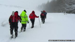 Motorists being escorted off the moorland