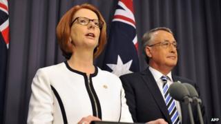 Julia Gillard (L) with Deputy Prime Minister Wayne Swan (R) in Canberra on 21 March 2013