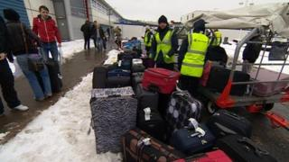 Luggage in the snow at East Midlands Airport