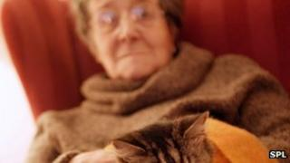 Elderly woman with her cat