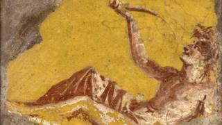Fragment of a wall painting showing a man reclining to drink