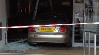 Rover 75 crashed through doors