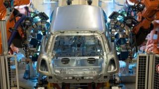 The shell of a Mini on a robotic production line