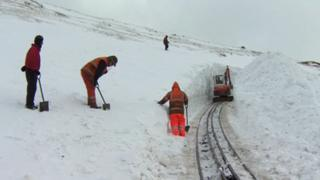 Teams clearing snow on Snowdon Mountain Railway in March, 2013