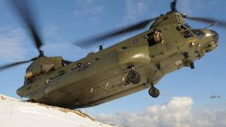 Military helicopter in operation during severe weather conditions in Northern Ireland