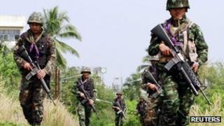 Thai security forces patrol the railway in the troubled southern province of Yala on 27 March 2013