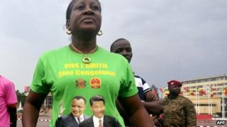 Woman wearing T-shirt of China's Xi Jinping (right) and Congo's Denis Sassou Nguesso in Brazzaville, 29 March 2013