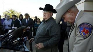 Mike McLelland (centre) at a press conference in January in Kaufman, Texas