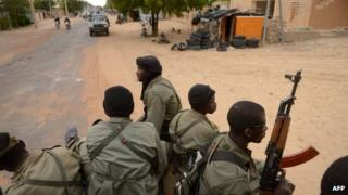 Malian soldiers enter the historic city of Timbuktu in January 2013, previously occupied for 10 months by Islamists