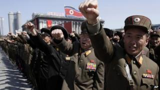 North Korean army officers punch the air as they chant slogans during a rally in Pyongyang, North Korea, 29 March 2013