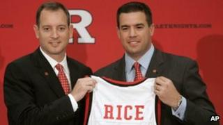 Rutgers athletic director Tim Pernetti, right, presents Mike Rice with a jersey after Rice was introduced as the school's men's basketball coach during a news conference in Piscataway, New Jersey 6 May 2010
