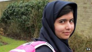 Malala Yousafzai, the Pakistani schoolgirl shot in the head by the Taliban, as she attends her first day of school just weeks after being released from hospital. 19 March 2013