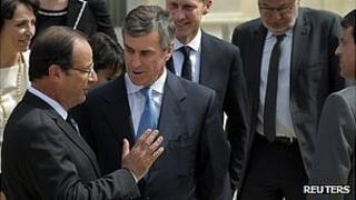 President Francois Hollande (left) talking to ex-budget minister Jerome Cahuzac, 3 Apr 13