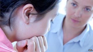 Teenager talking to a school nurse