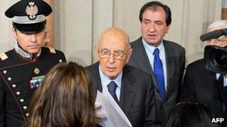 President Giorgio Napolitano (centre) speaking to press - file pic