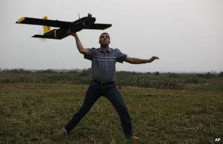 Remo Peduzzi, managing director of ResearchDrones LLC Switzerland, prepares to fly a drone at the Kaziranga National Park at Kaziranga in Assam state, India, 8 April