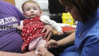 Lauren Durbin receives the MMR jab at Morriston Hospital in Swansea