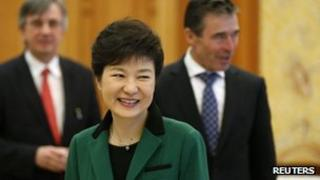 South Korean President Park Geun-hye (front) and Nato Secretary-General Anders Fogh Rasmussen (right) at the presidential Blue House in Seoul, 12 April 2013