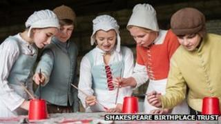 children taking part in a Tudors Alive educational session at Mary Arden's Farm