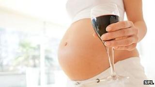 Pregnant bump and wine glass